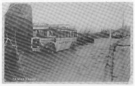 Black & White bus on Worcester Road with Mythe Hill in background.<br>This is the only road that has been completely lifted.